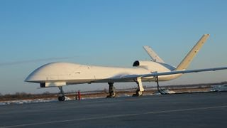 China's new unmanned, armed reconnaissance drone the WJ-700 has successfully completed its maiden flight.